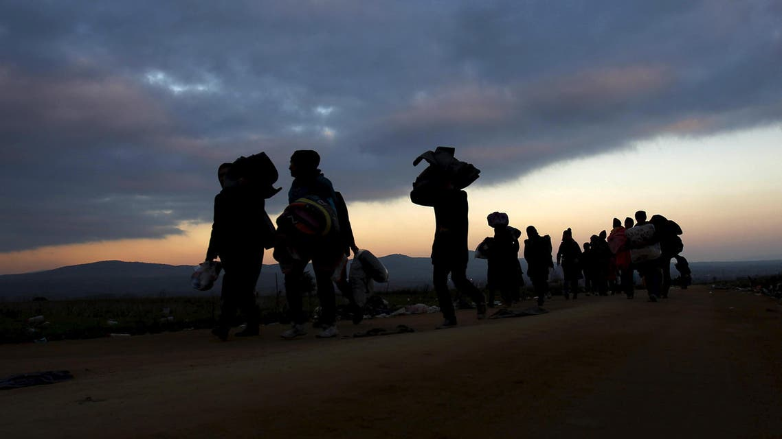 Migrants walk towards a village after entering from Macedonia by foot in Miratovac, Serbia, October 24, 2015. (Reuters)
