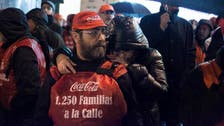 Spanish workers celebrate victory over Coca-Cola
