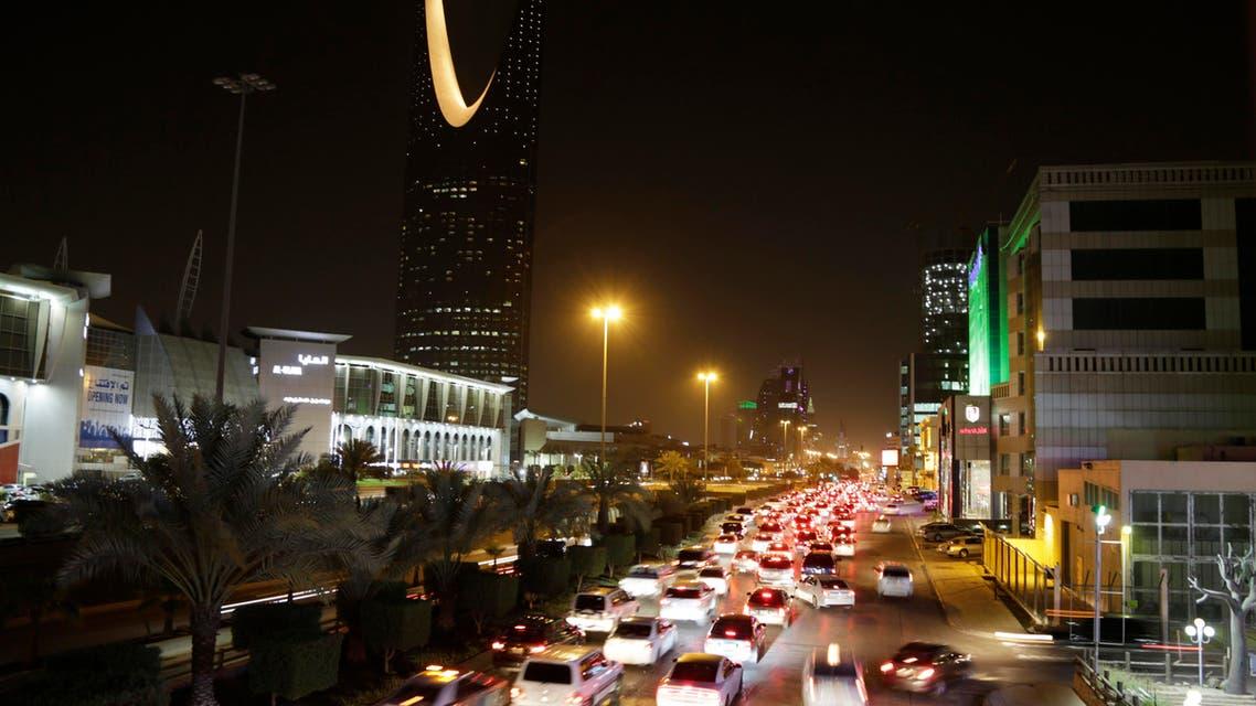 Cars pass by the kingdom tower Sunday, June 14, 2015, in Riyadh, Saudi Arabia. (AP)