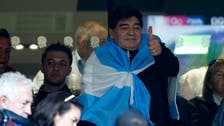 With a blow of a kiss, Maradona roars on Argentina