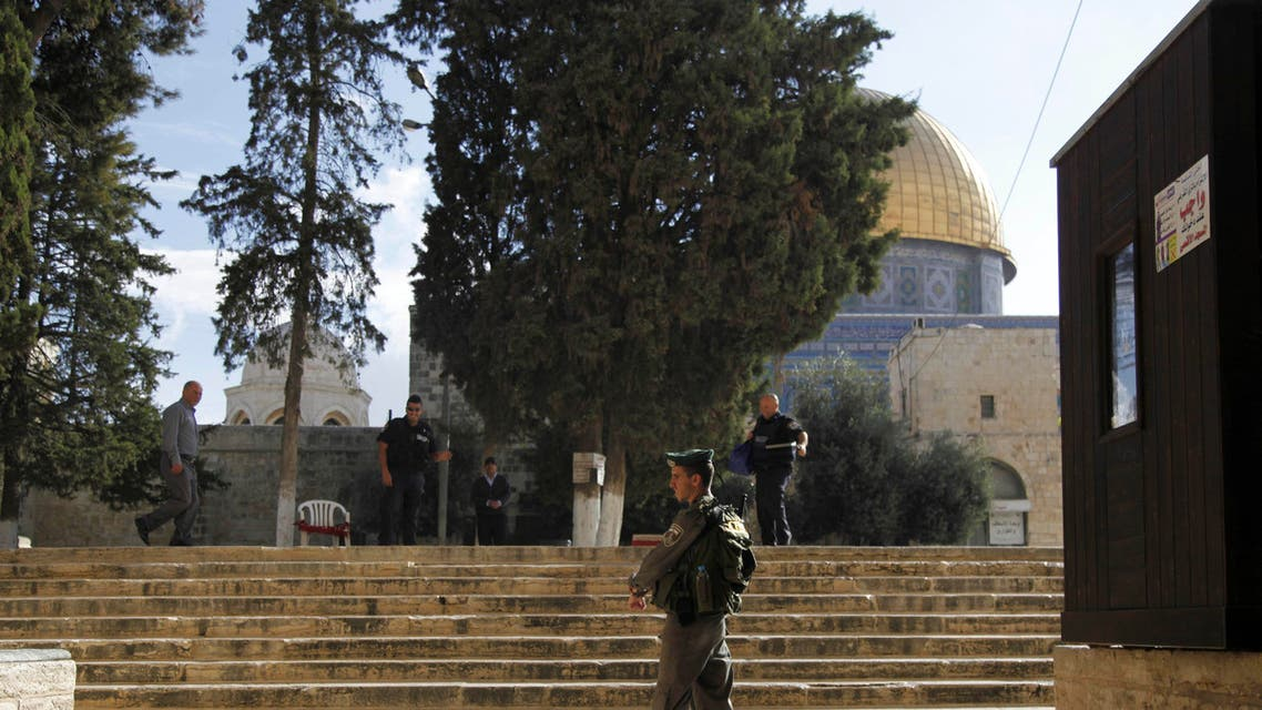 Israeli police stands guard at the entrance to Al-Aqsa compound in Jerusalem's Old City Thursday, Oct. 8, 2015. AP
