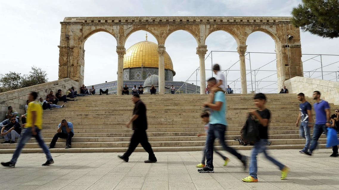 The Dome of the Rock is seen in the background as Palestinians wait for Friday prayers to begin in Jerusalem's Old City. (Reuters)