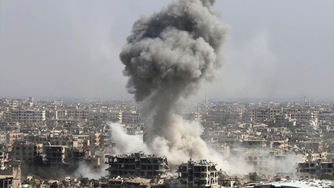 In this photo taken on Wednesday, Oct. 14, 2015, smoke rises after shelling by the Syrian army in Jobar, Damascus, Syria. Backed by Russian airstrikes, the Syrian army has launched an offensive in central and northwestern regions. AP