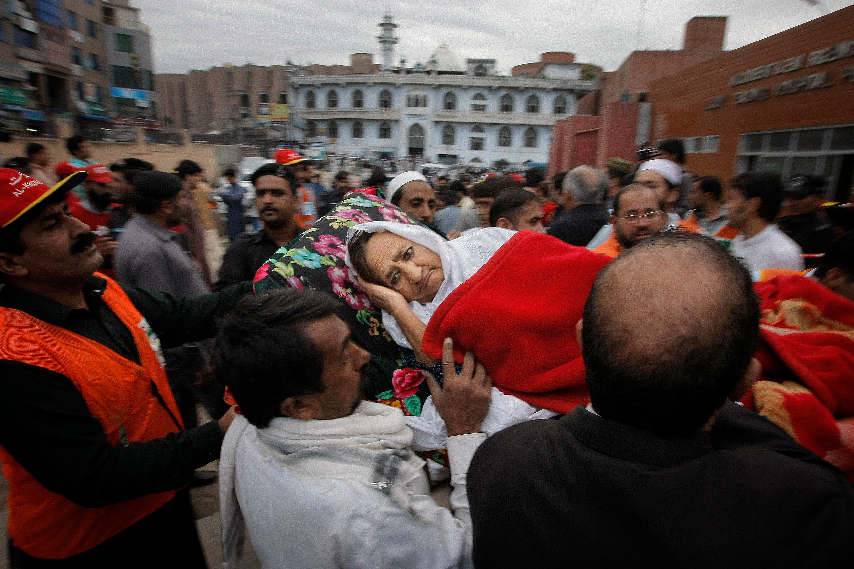 AP_497440093059People rush an injured woman to a local hospital in Peshawar, Pakistan, Monday, Oct. 26, 2015. (AP)