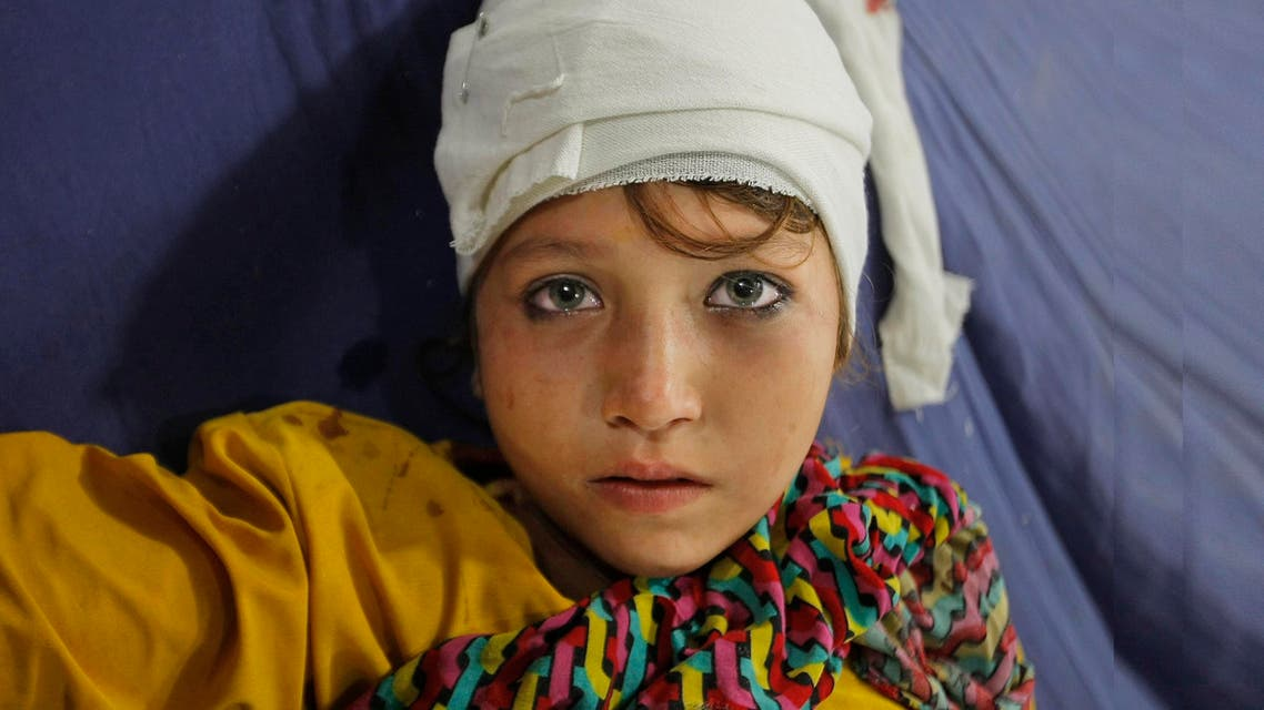 A girl injured from an earthquake admits at a local hospital in Peshawar, Pakistan, Monday, Oct. 26, 2015. (AP)