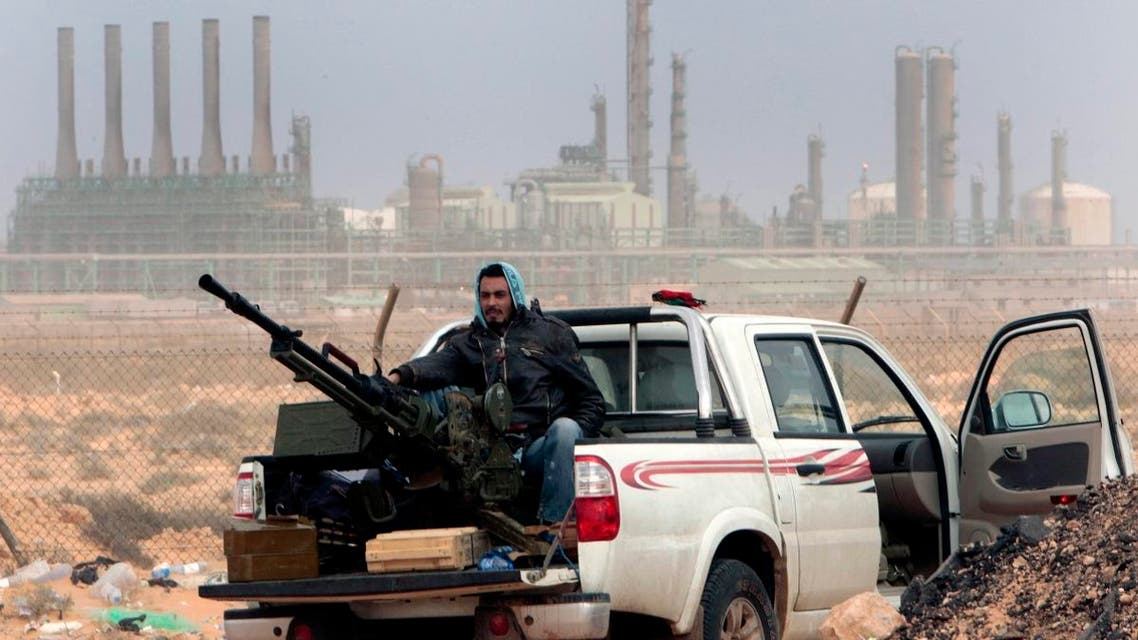 In this March 5, 2011 file photo, an anti-government rebel sits with an anti-aircraft weapon in front an oil refinery, after the capture of the oil town of Ras Lanouf, eastern Libya. (AP)