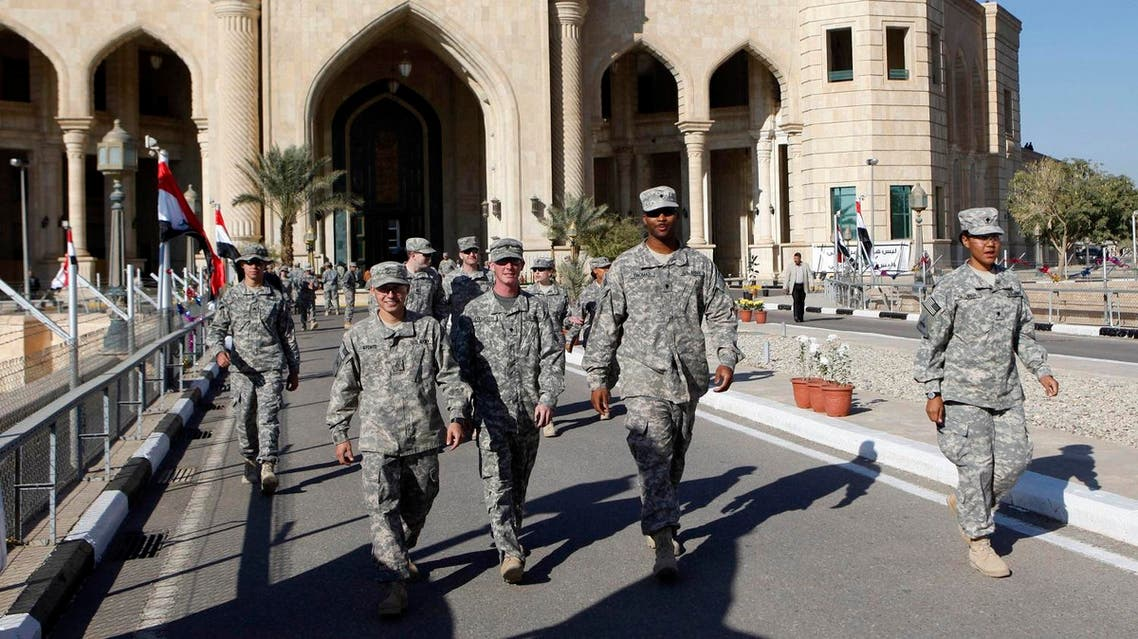 U.S. soldiers leaving Al Faw palace at Camp Victory, one of the last American bases in Iraqcountry where U.S. military footprint swiftly shrinking, after a special ceremony in Baghdad, Iraq, Thursday, Dec. 1, 2011.