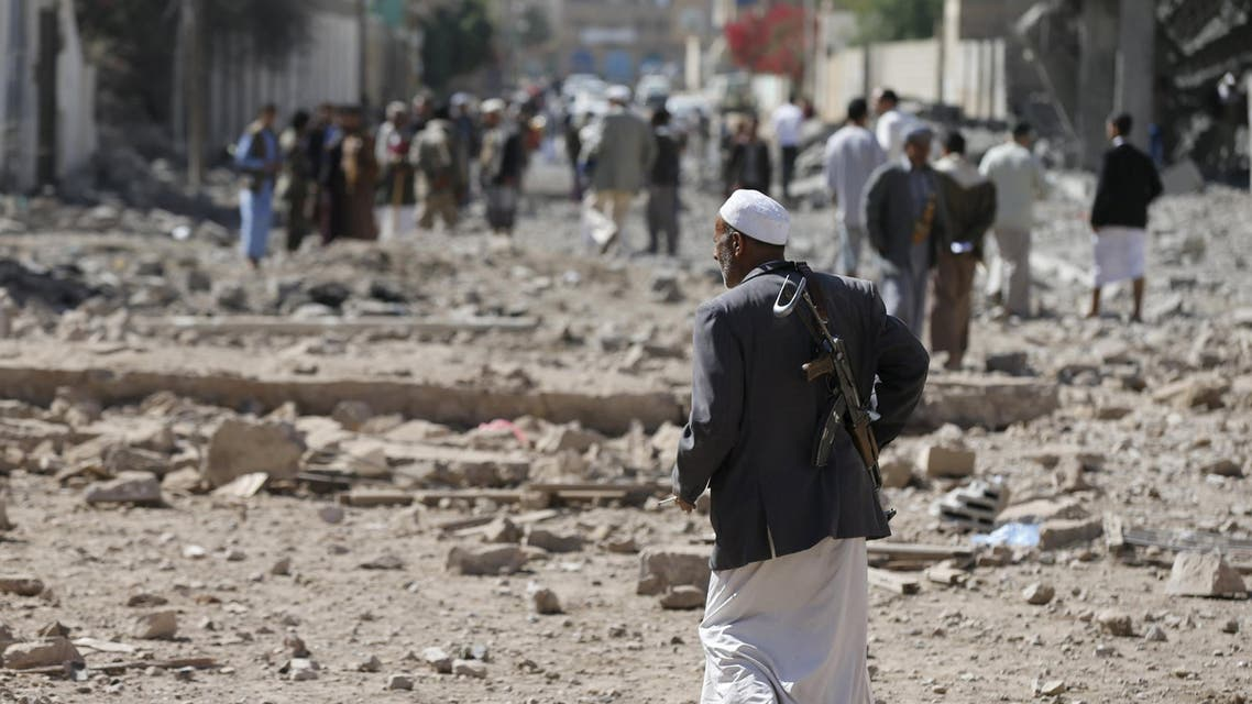 A Houthi militant walks at the site of Saudi-led air strikes in Yemen's capital Sanaa October 28, 2015. reuters