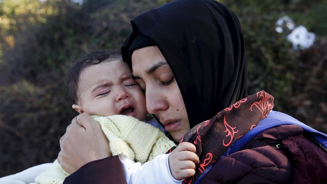 A Syrian refugee hugs her crying baby after arriving on a raft on the Greek island of Lesbos, October 27, 2015. (Reuters)