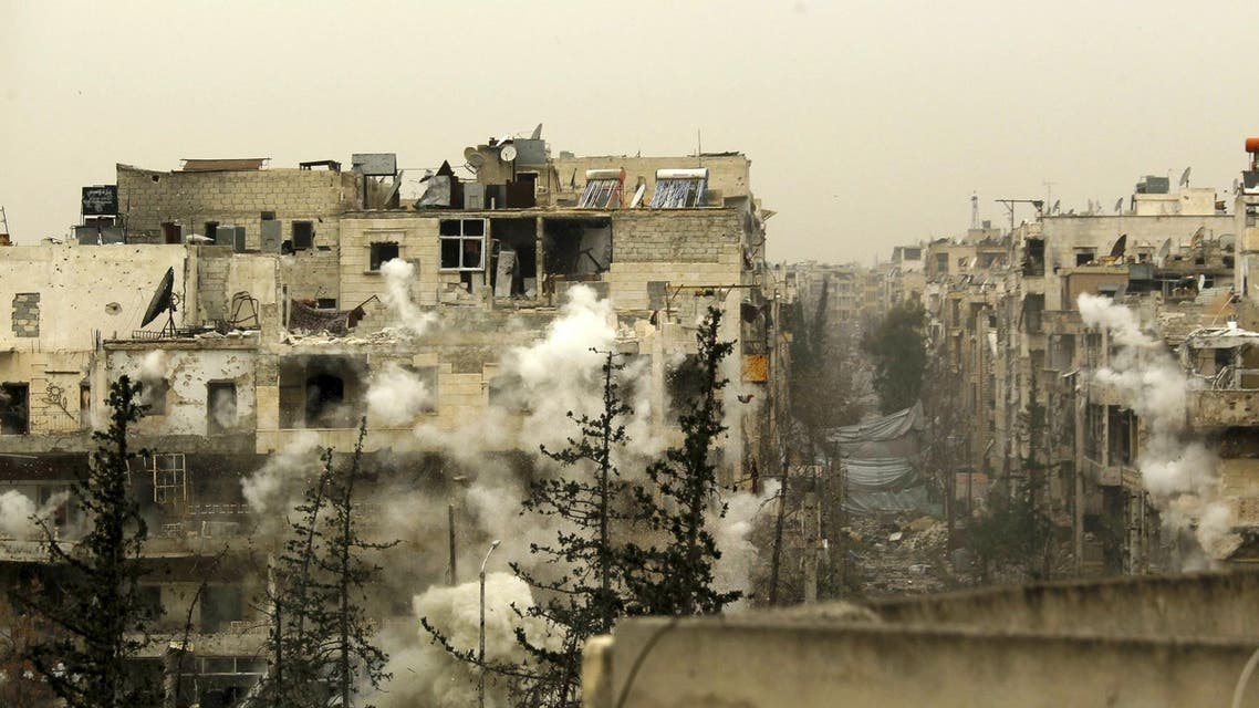 Smoke rises after a shell fell on a building that forces loyal to Syria's president Bashar Al-Assad are located in, after being fired from rebel fighters in the Seif El Dawla neighbourhood in Aleppo March 28, 2015.