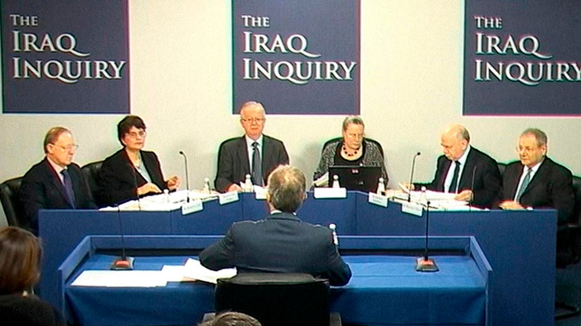 A still image from video shows former British Prime Minister Tony Blair (BACK TO CAMERA) speaking at an inquiry into Britain's role in the Iraq War, at the Queen Elizabeth II Conference Centre, London Jan. 21, 2011. (Reuters)