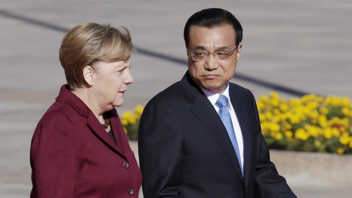 رئيس الوزراء الصيني لي كه تشيانغ مع ميركل في بكين