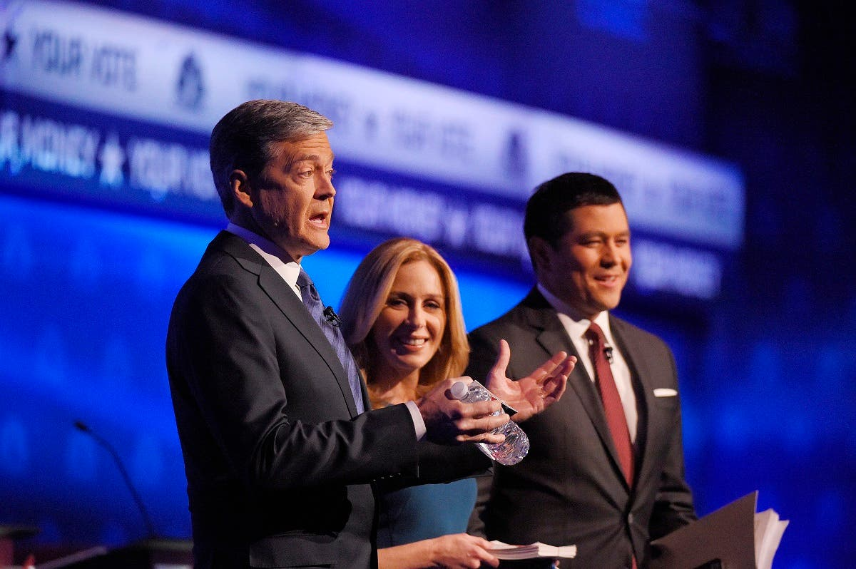 Debate moderators John Harwood, left, Becky Quick, center, and Carl Quintanilla take the stage during the CNBC Republican presidential debate at the University of Colorado. (AP)
