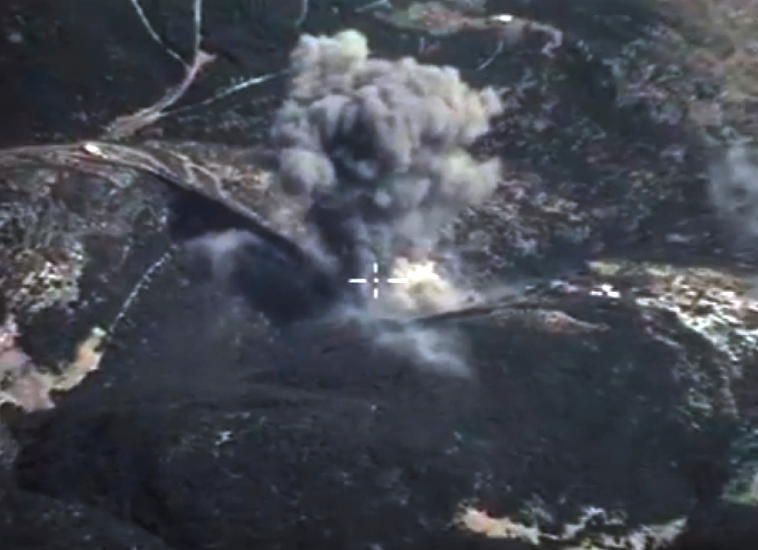 In this photo made from the footage taken from Russian Defense Ministry official web site on Sunday, Oct. 4, 2015, an aerial view of a bomb explosion in Syria.  AP