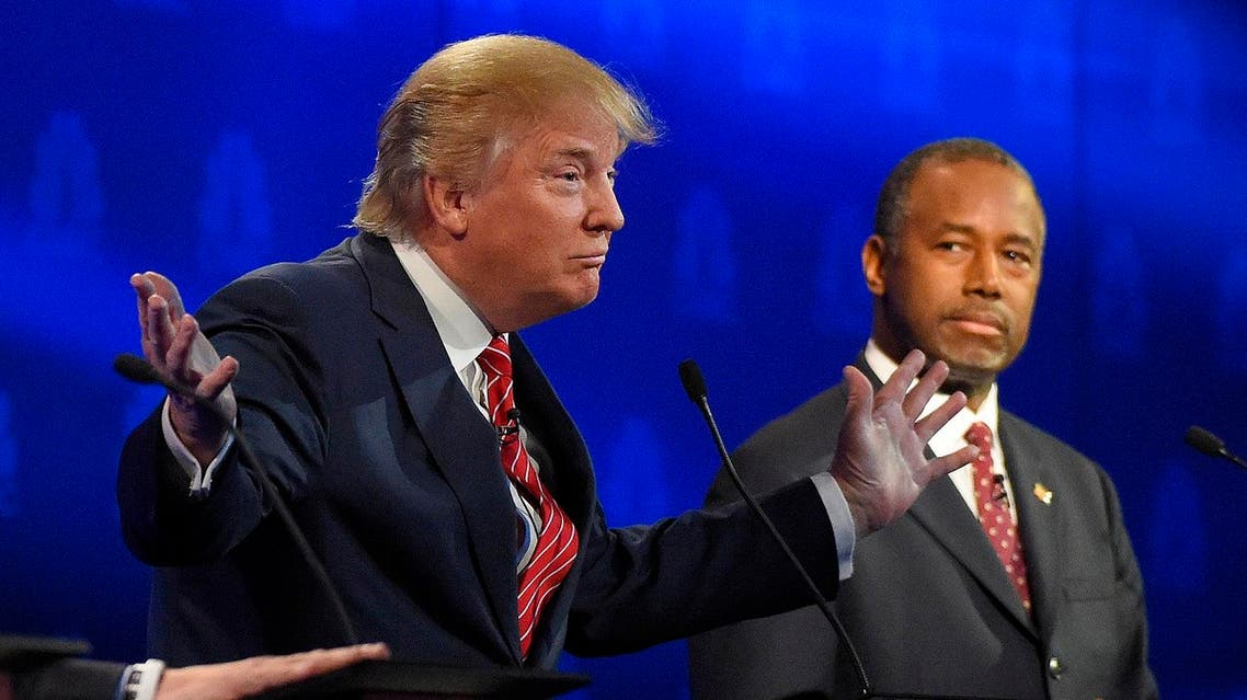 Ben Carson, right, watches as Donald Trump speaks during the CNBC Republican presidential debate at the University of Colorado. (AP)