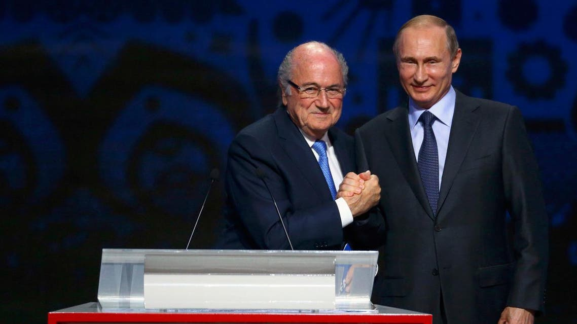 FIFA's President Sepp Blatter shakes hands with Russia's President Vladimir Putin (R) during the preliminary draw for the 2018 FIFA World Cup at Konstantin Palace in St. Petersburg. (Reuters)