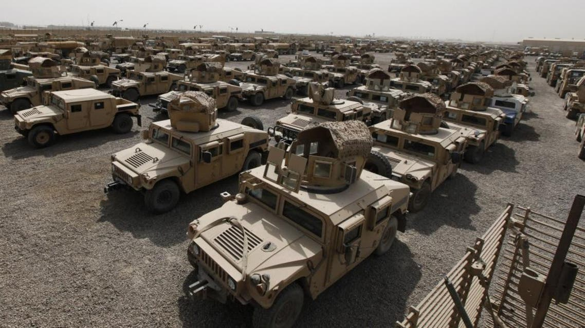 A view of humvees parked at a courtyard at Camp Liberty in Baghdad, September 30, 2011. REUTERS/Mohammed Ameen