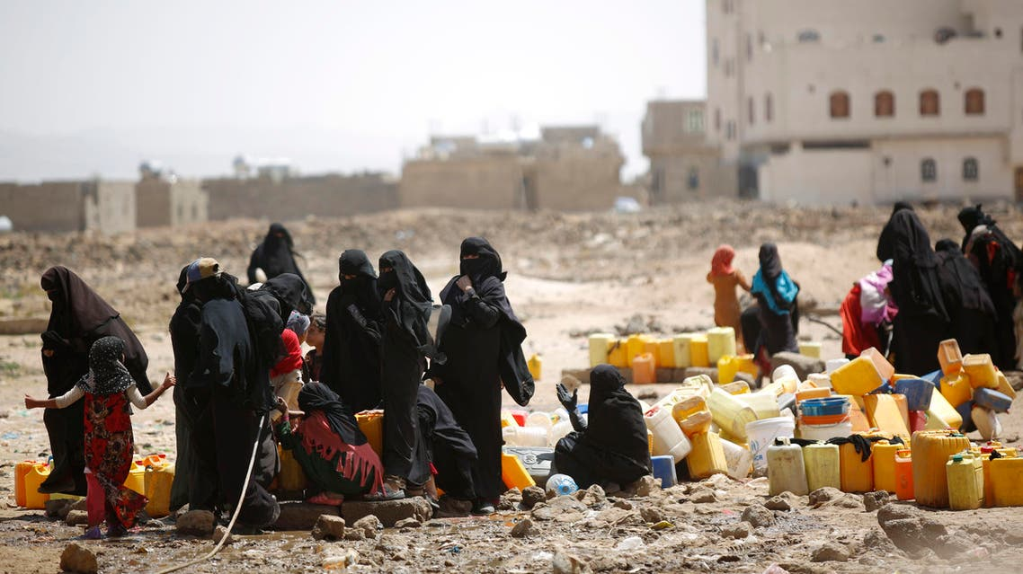 Women and children fill buckets with water from a public tap amid an acute shortage of water, on the outskirts of Sanaa, Yemen, Tuesday, Oct. 13, 2015. (AP)