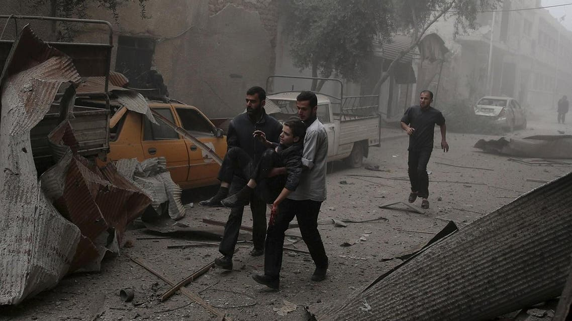 Residents carry an injured man in the town of Douma after an airstrike, eastern Ghouta in Damascus October 29, 2015.  (AP)
