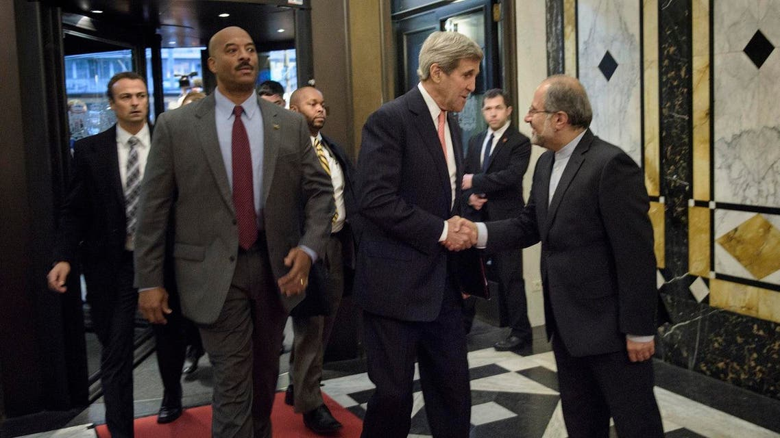 Secretary of State John Kerry is greeted by Iranian Foreign Minister Javad Zarif 's chief of staff (R) before a meeting with the foreign minister at the Hotel Bristol in Vienna, Austria on Oct. 29. (AP)