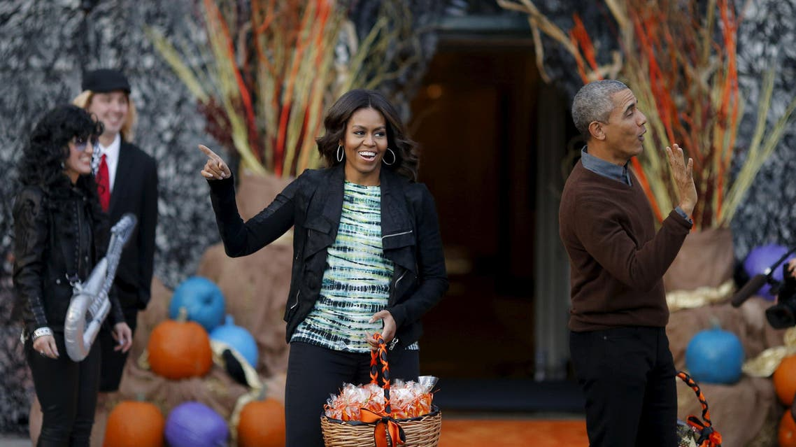 U.S. President Barack Obama and first lady Michelle Obama wave as they arrive at a Halloween trick-or-treating celebration on the South Lawn of the White House in Washington. (Reuters)