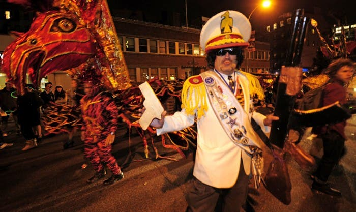 A man dressed as dead Libyan leader Muammar Gaddafi takes part in the New York Halloween parade.