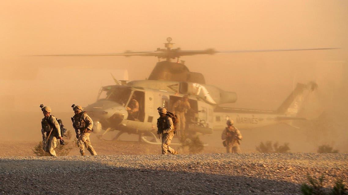 A Marine Corps UN-1Y Huey helicopter inserts Marines during a raid exercise on K-9 Village, Yuma Proving Ground, Ariz., Oct. 1, 2014.  (Photo courtesy of U.S. Marines)