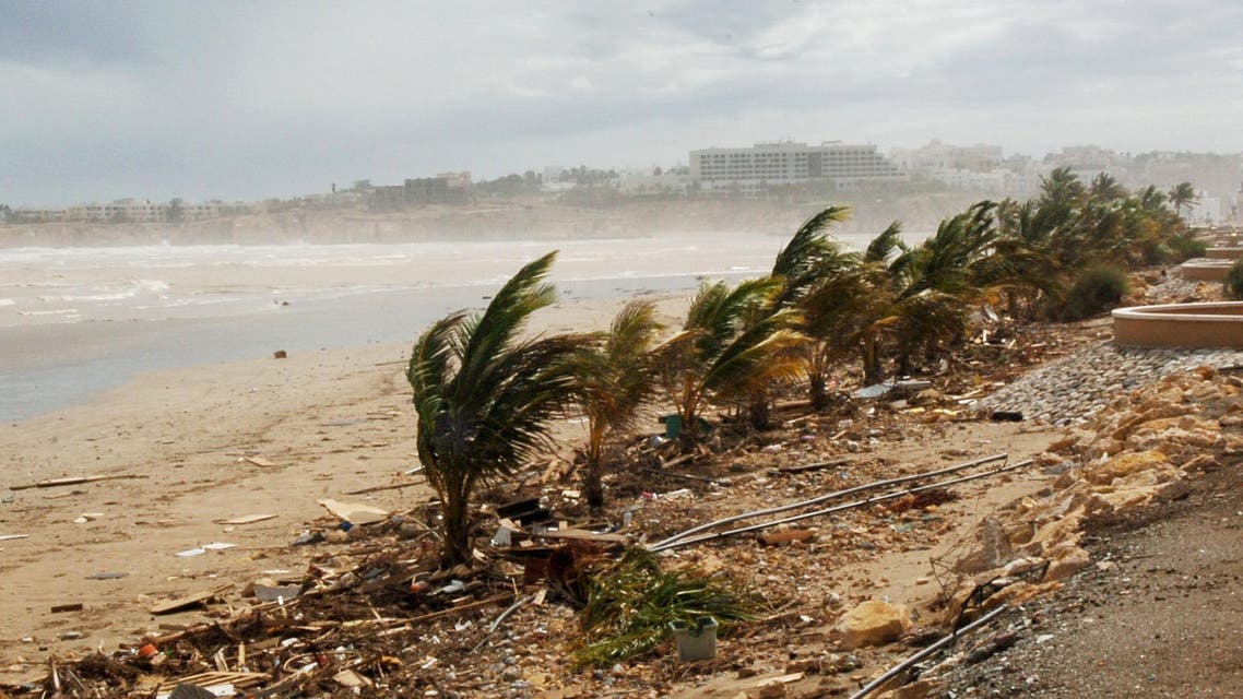 Debris is strewn on the beach as high winds, the remnants of Cyclone Gonu, whip up spray in the sea, in Muscat, Sultanate of Oman, Saturday, June 9, 2007. Cyclone Gonu romped through the tidy Omani capital on Thursday before heading north across the Gulf of Oman and hitting Iran. At the height of the storm in Oman, winds swept up to 95 mph (153 kph), according to the U.S. military's Joint Typhoon Warning Center. Oman's weather center said that Gonu was believed to be the strongest and deadliest storm to strike Oman since 1977, when 500 people were killed. (AP Photos/Hamid Al-Qasmi)