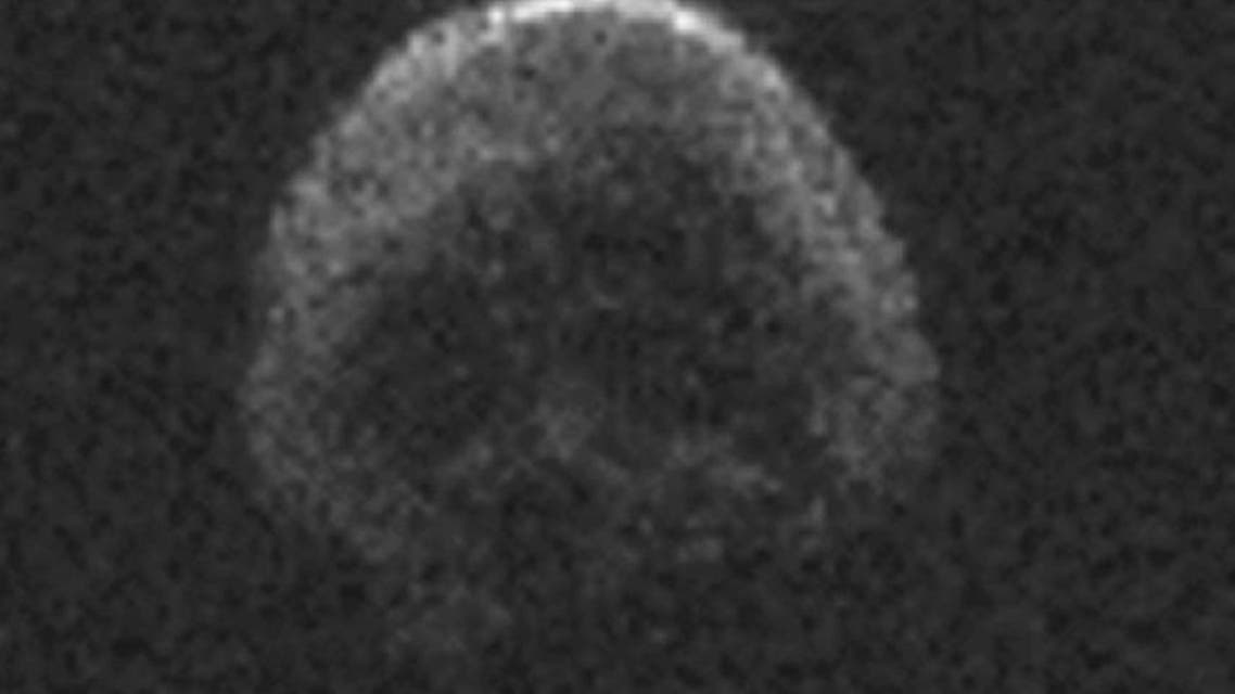A massive space rock that will shave by Earth on Halloween looks like a dead comet with a skull face, NASA says (AFP Photo/)