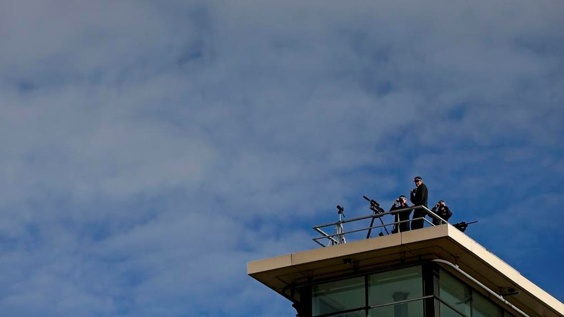 Armed police officers keep watch from the roof of an building in Manchester, Britain. (File: Reuters)