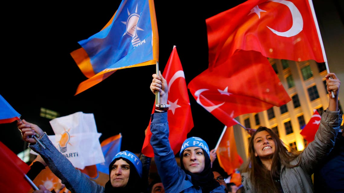 Women wave flags outside the AK Party headquarters in Ankara, Turkey November 1, 2015. REUters