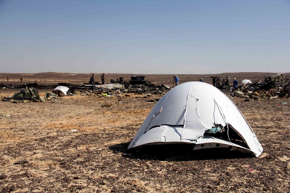 Debris of a Russian airplane is seen at the site a day after the passenger jet bound for St. Petersburg, Russia, crashed in Hassana, Egypt, on Sunday, Nov. 1, 2015. AP