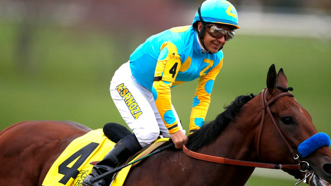 Victor Espinoza aboard American Pharoah celebrates after crossing the finish line in race eleven to win the 2015 Breeders Cup Championships. (Reuters)
