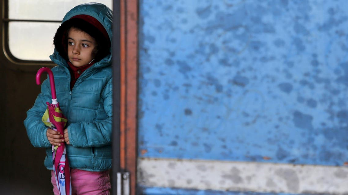 A migrant child stands in a train cabin on arrival near the border with Serbia, at a railway station in Tabanovce. (Reuters)