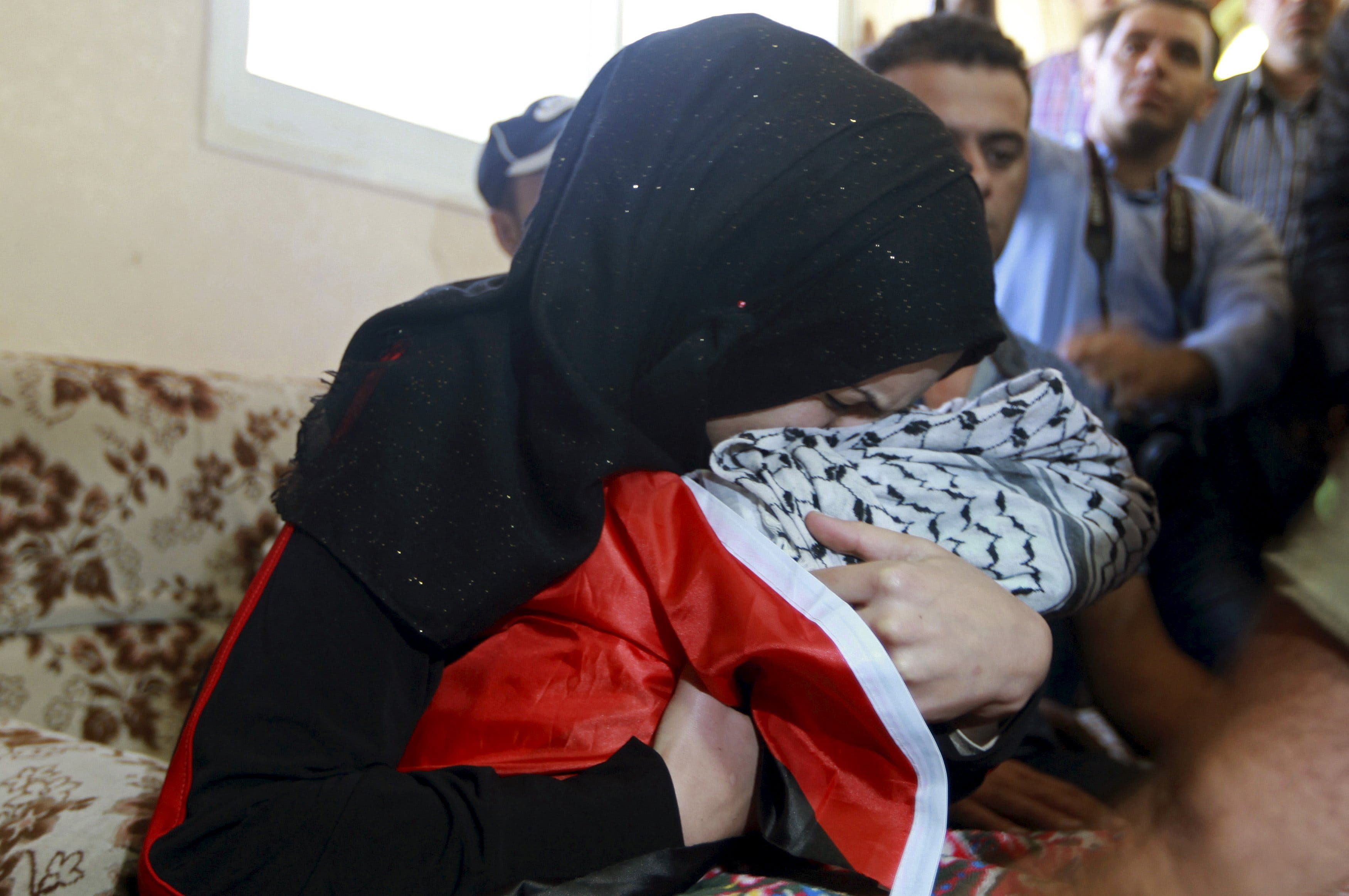 The mother of eight-month-old Palestinian baby Ramadan Thawabtah, who the health ministry said died after inhaling tear gas fired by Israeli troops on Friday. (Reuters)