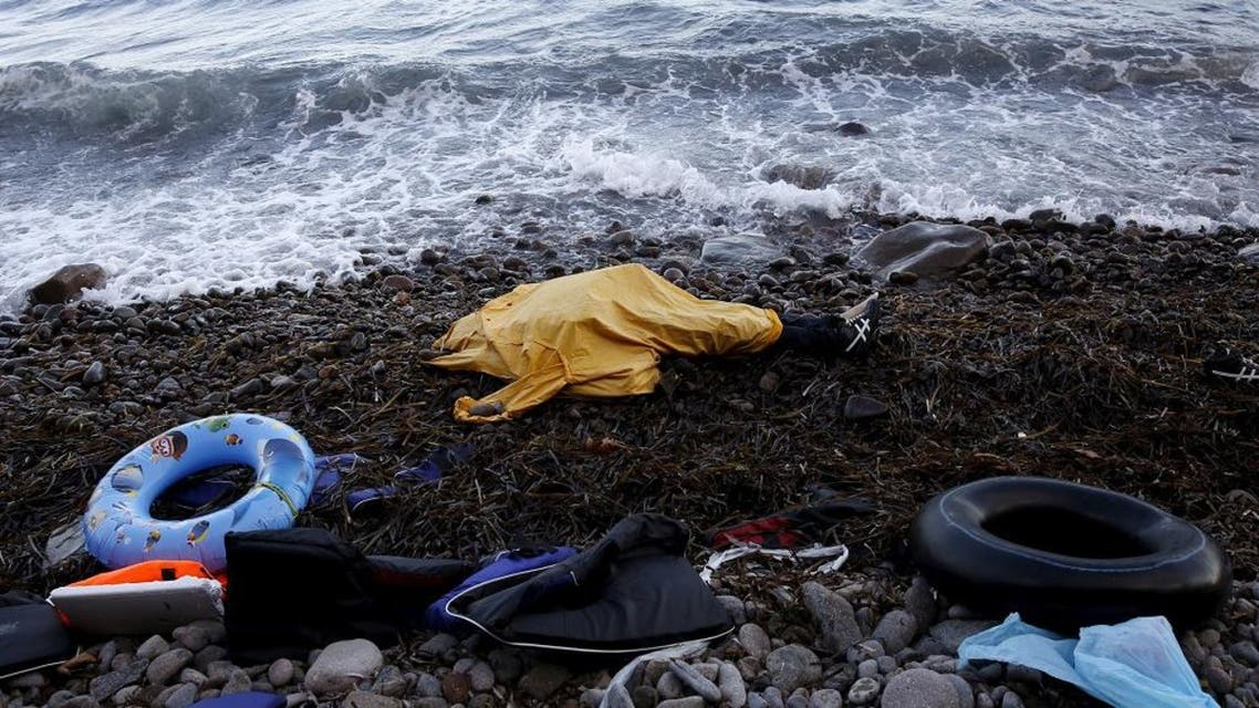 The covered body of a migrant man lies at a beach after being washed ashore on the Greek island of Lesbos November 1, 2015. (Reuters)