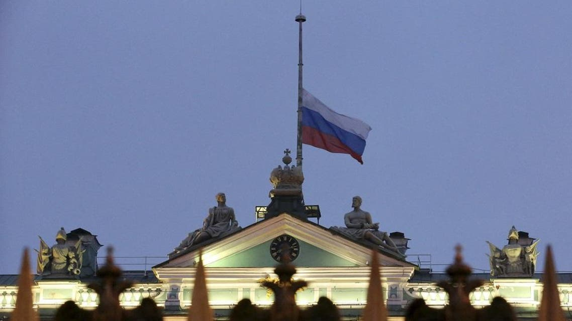 The Russian national flag flies at half-mast on the roof of the State Hermitage Museum in St. Petersburg, Russia November 1, 2015. REU