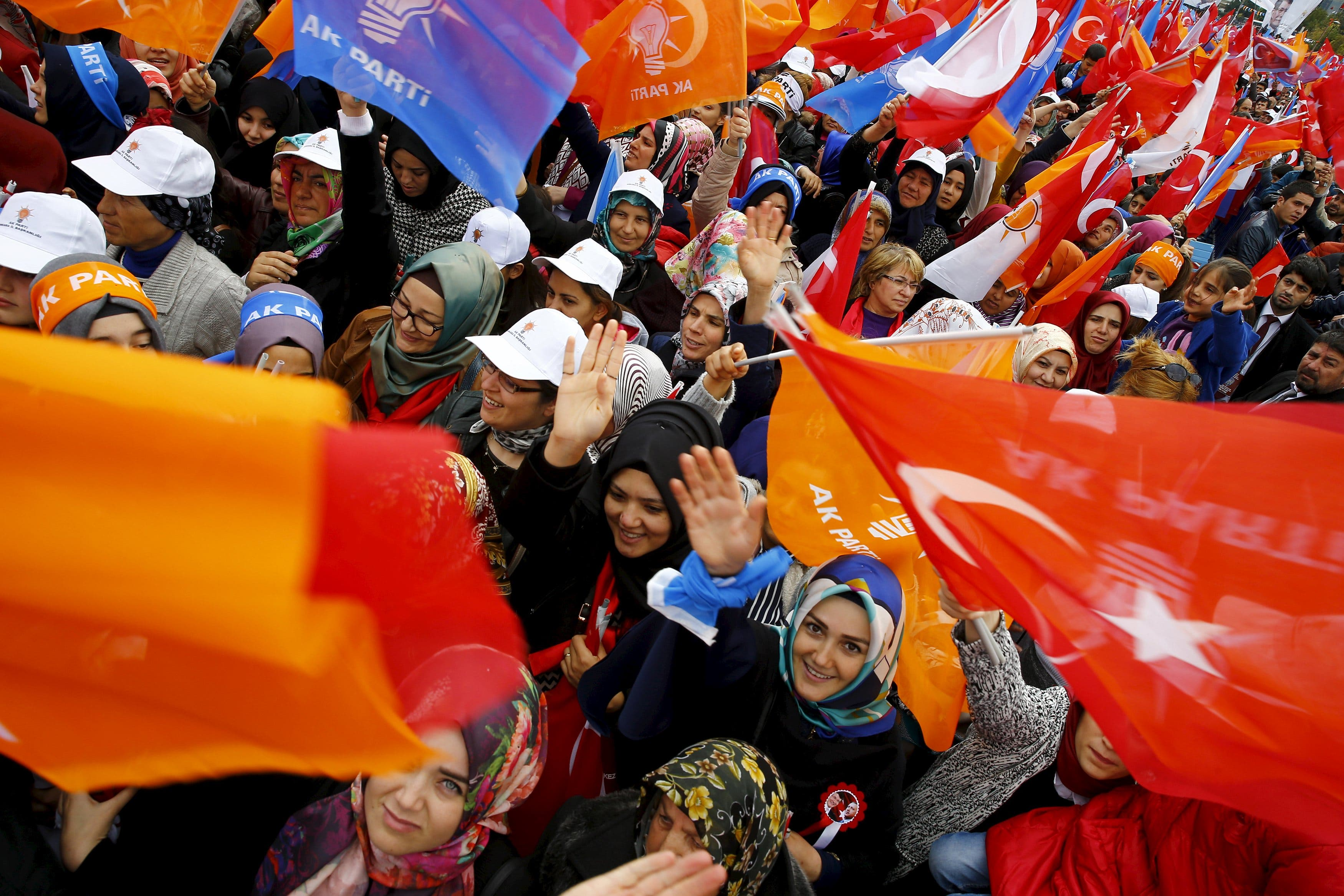 Supporters of the ruling AK Party wave national and party flags during an election rally in Ankara, Turkey, October 31, 2015