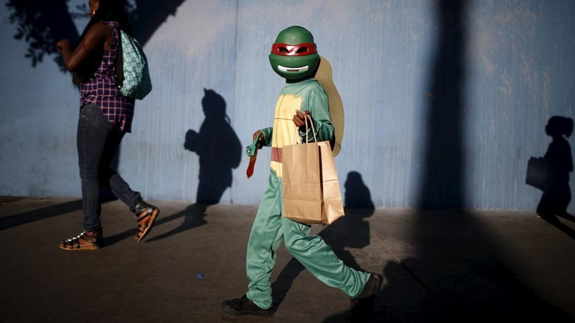Children participate in the School on Wheels Skid Row Halloween Parade for children who live in shelters, motels, cars and on the street, in Los Angeles, California, United States, October 30, 2015. (File: Reuters)