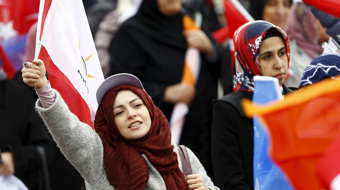 Supporters of the ruling AK Party wave national and party flags during an election rally in Ankara, Turkey, October 31, 2015.