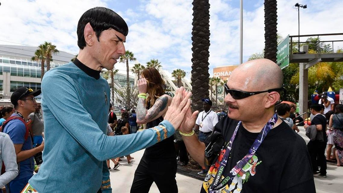 Spock Vegas dressed as Star Trek's Mr. Spock gives the 'live long and prosper' high five to a fan at the 2015 Comic-Con International in San Diego. (File: AP)