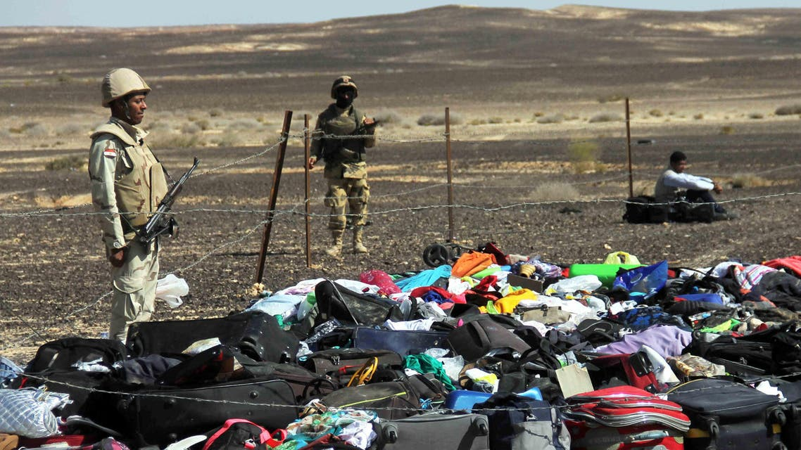 Egyptian Army soldiers stand near luggage and personal effects of passengers a day after a passenger jet bound for St. Petersburg, Russia crashed in Hassana, Egypt, on Sunday, Nov. 1, 2015. (AP)