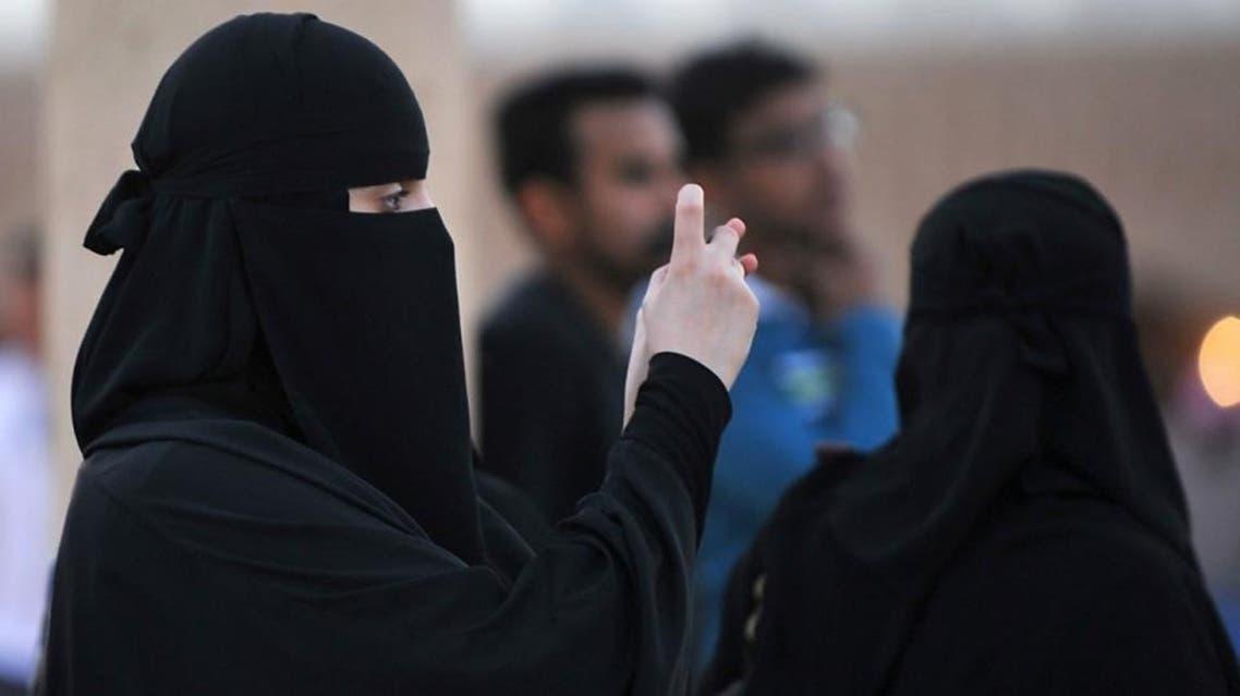 A Saudi woman uses her cellphone in the village of al-Thamama, near Riyadh, Feb. 22, 2014. (AFP)