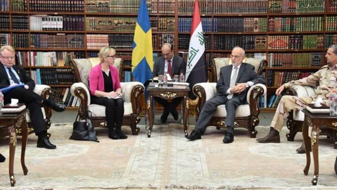 وزير الخارجية العراقي إبراهيم الجعفري مع نظيرته السويدية ووزير الدفاع السويدي