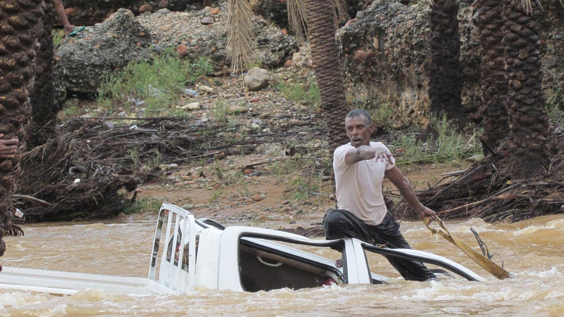 A man gestures as he tries to save a vehicle swept away by flood waters in Yemen's island of Socotra November 2, 2015. A rare tropical cyclone packing hurricane-force winds killed three people and injured scores on the Yemeni island of Socotra on Monday, residents and officials said. REUTERS/Stringer EDITORIAL USE ONLY. NO RESALES. NO ARCHIVE TPX IMAGES OF THE DAY