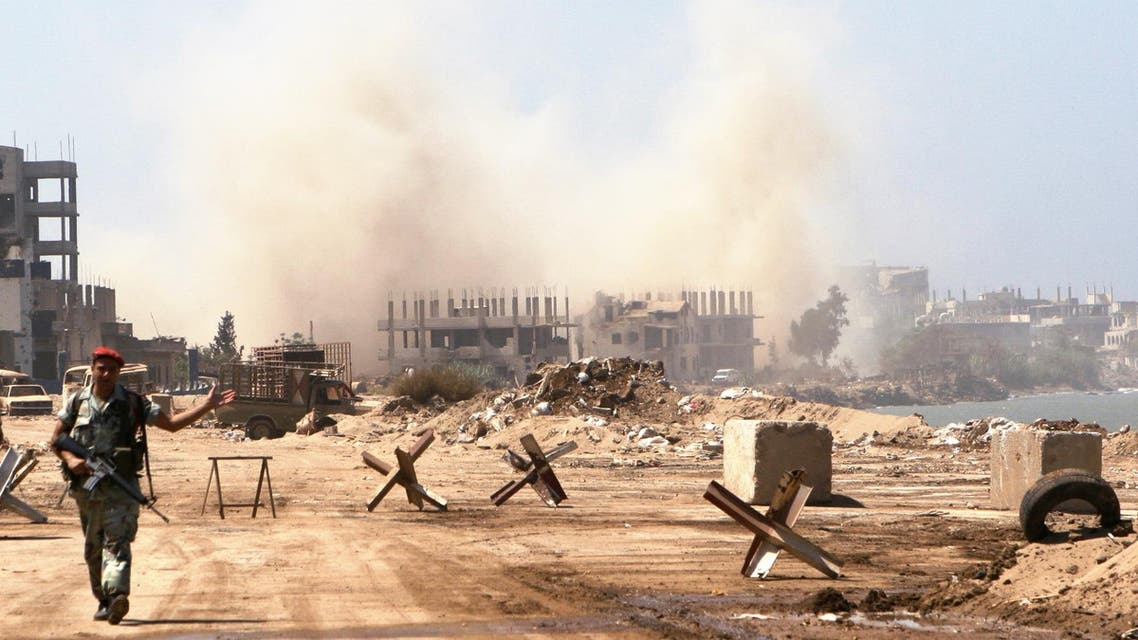 A Lebanese soldier patrols the entrance of the Palestinian refugee camp of Nahr el-Bared as smoke rises from the destruction of unexploded shells, mines and other explosives left behind by Fatah Islam militants in Tripoli, Lebanon Friday, Sept. 7, 2007. (AP)