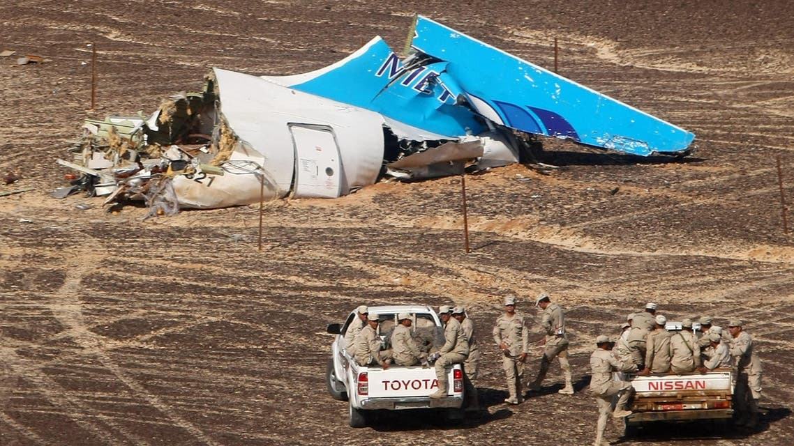 In this photo made available Monday, Nov. 2, 2015, and provided by Russian Emergency Situations Ministry, Egyptian Military on cars approach a plane's tail at the wreckage of a passenger jet bound for St. Petersburg in Russia that crashed. (AP)