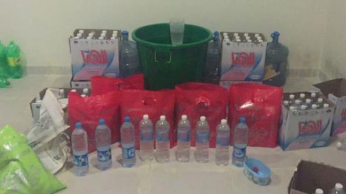 Liquor bottles found in an apartment in Riyadh's Al-Faiyha District. — SG photo