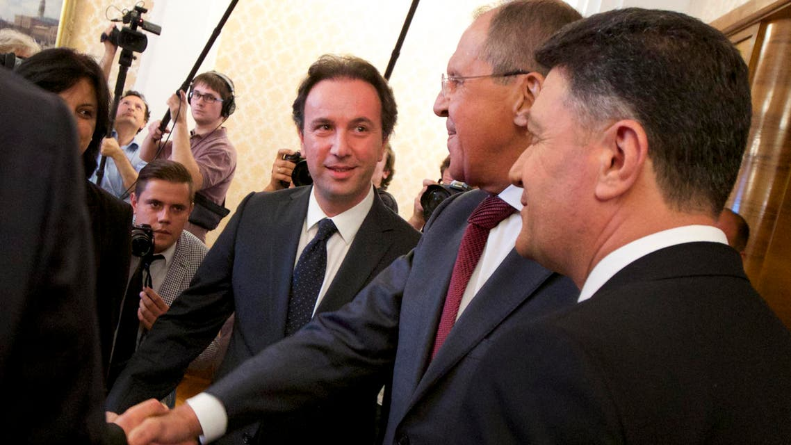 Russian Foreign Minister Sergey Lavrov, second right, and Syrian National Coalition president Khaled Khoja, third right, meet in Moscow, Russia, Thursday, Aug. 13, 2015. Russia's foreign minister on Thursday hosted a delegation of the main Syrian opposition group, part of the Kremlin's new push for a mediation role in the Syrian conflict. (AP Photo/Ivan Sekretarev)