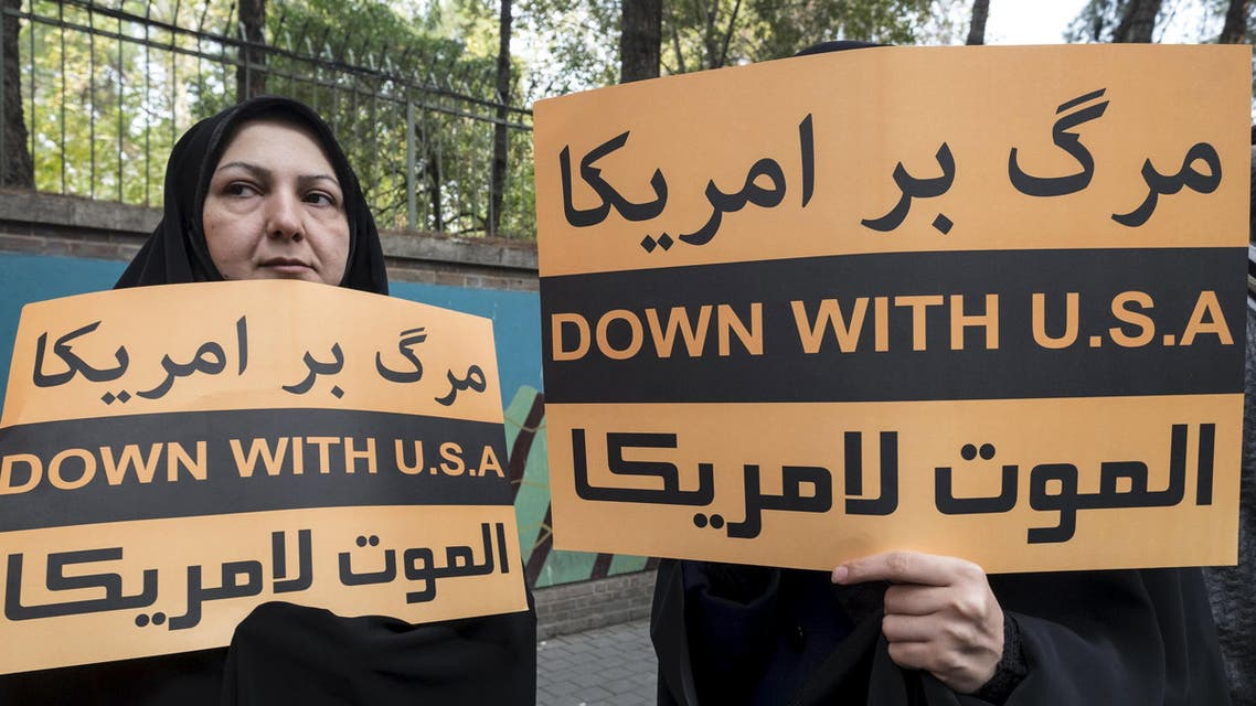 Women hold anti-U.S. banners during a demonstration outside the former U.S. embassy in Tehran November 4, 2015. REUTERS/Raheb Homavandi/TIMA ATTENTION EDITORS - THIS IMAGE WAS PROVIDED BY A THIRD PARTY. FOR EDITORIAL USE ONLY.